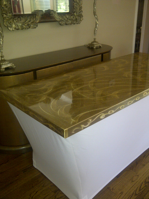 gold swirled tabletop with spandex linens