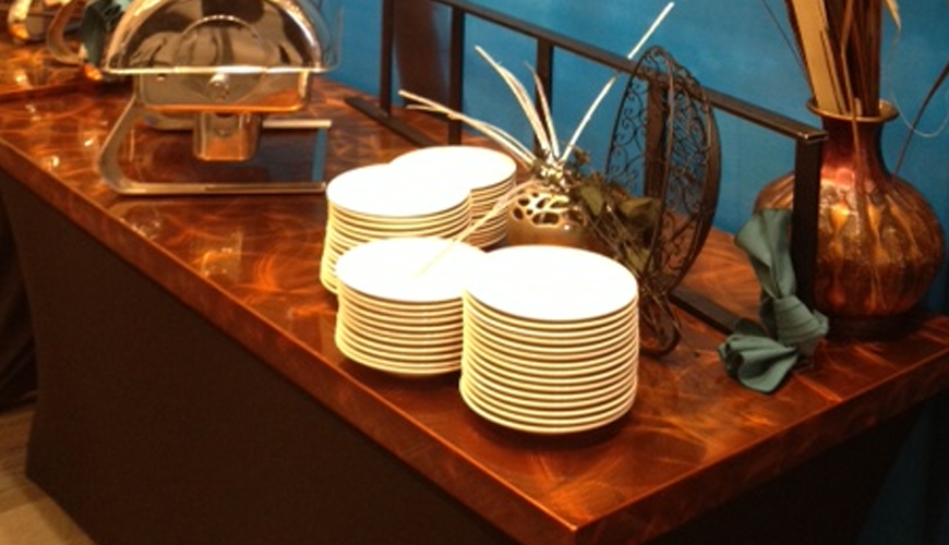 Copper buffet tabletop with serving plates