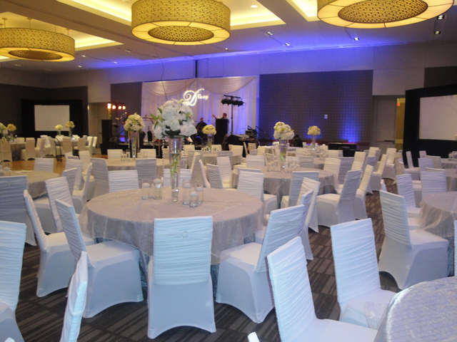 white ruched chair covers for a wedding