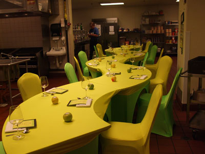 serpentine tables with yellow spandex