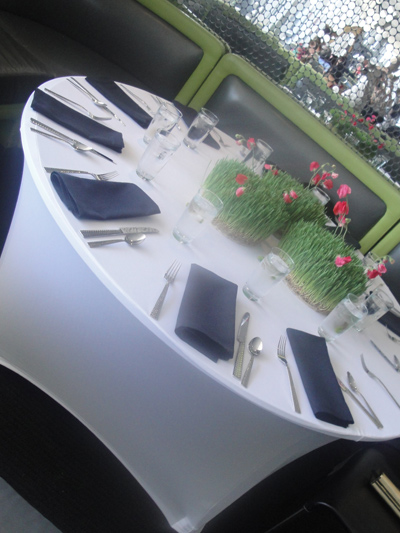 round dinner table with white spandex linens